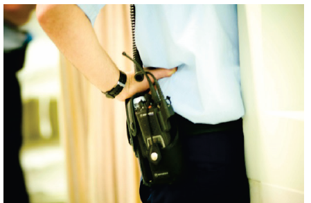 A picture of a security guard with a walkie talkie on his hip. Photo courtesy of St Vincent's Hospital Melbourne.