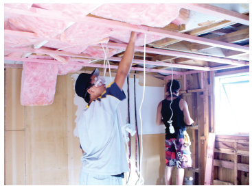 Image of two building working on the inside of a house
