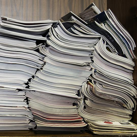 A pile of documents and magazines. Photo courtesy of Oleg Golovnev/Shutterstock.com