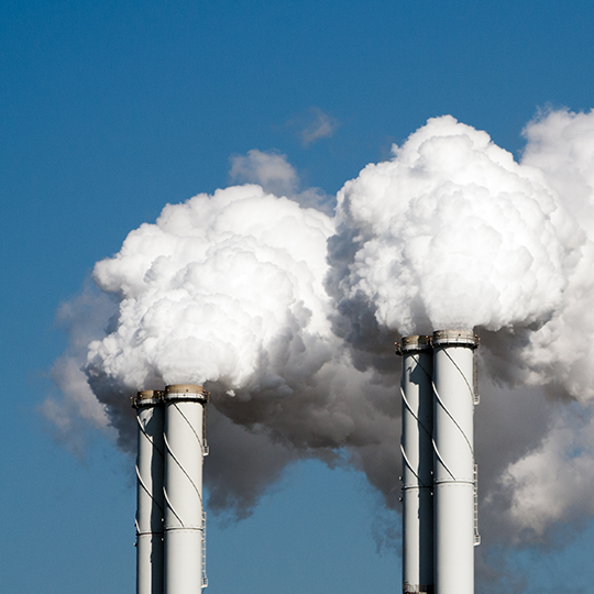 Air pollution from power plant chimneys. Photo courtesy of VanderWolf Images/Shutterstock.com