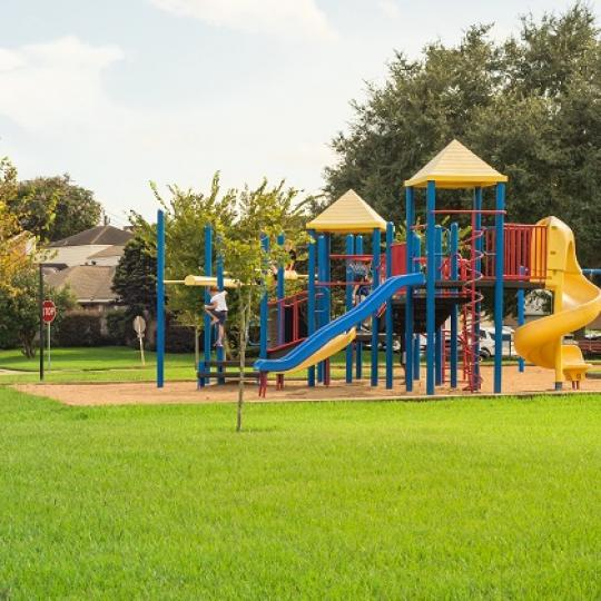 Children's playground in open park. Photo by Trong Nguyen/shutterstock.com