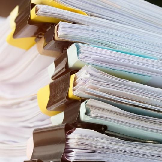 Stack of paperwork files. Photo courtesy of smolaw/shutterstock.com