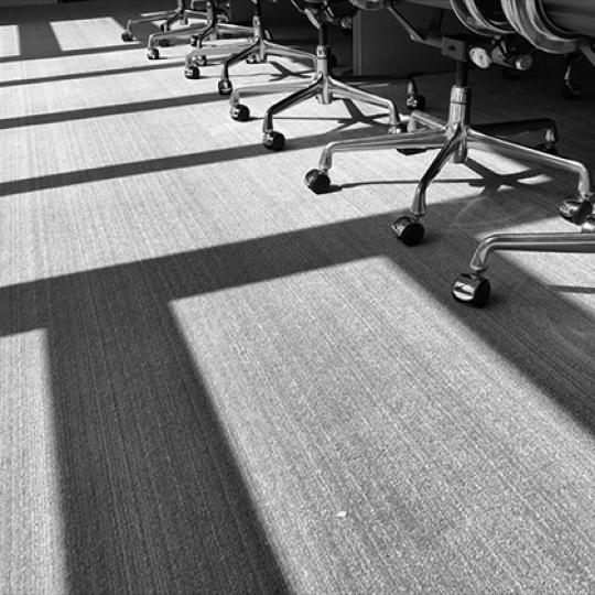 A row of chairs and shadows in the afternoon sun. Image by TBaker770/Shutterstock.com