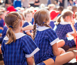 School children sitting at an assembly. Photo courtesy of Jandrie Lombard/Shutterstock.com